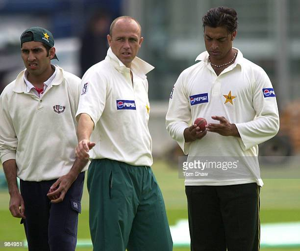 Shoaib Akhtar of Pakistan has a chat with the team coach Richard Pybus during the Pakistan nets session prior to the 1st test at Lords Cricket Ground...