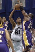Tim Duncan the San Antonio Spurs shoots over Hoarce Grant of the Los Angeles Lakers during game one of the Western Conference Finals at the Alamo...
