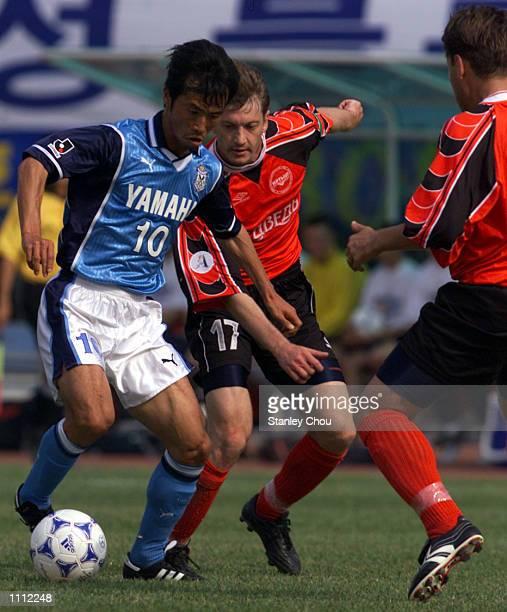 Toshiya Fujita of Jubilo Iwata is challenged by Klishin Alexey of Irtysh Pavlodar during the Asian Club Football Championship semifinal at the Suwon...