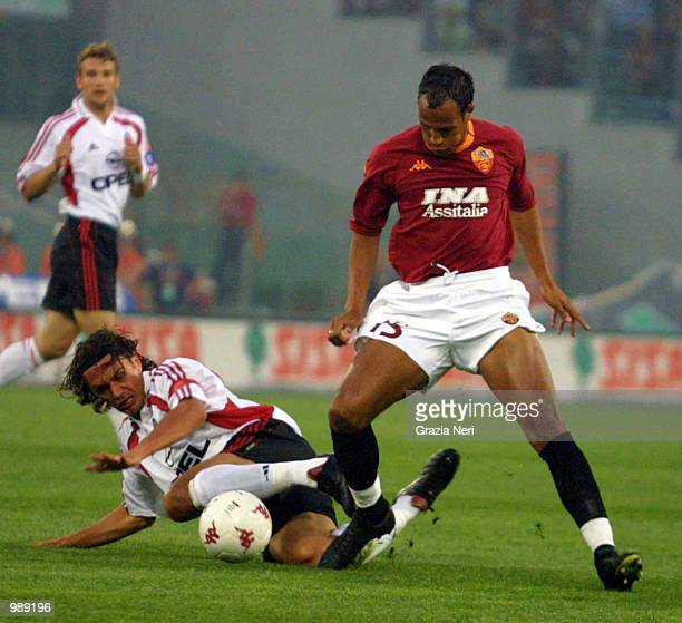 Zebina of Roma is tackled by Paolo Maldini of Milan during the AS Roma v AC Milan Serie A match played at the Olympic Stadium in Rome Mandatory...