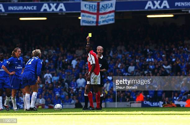 Patrick Vieira of Arsenal is shown a yellow card by referee Mike Riley during the AXA sponsored FA Cup Final between Arsenal and Chelsea played at...