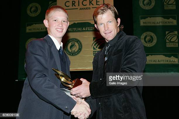 May 2006 Jonty Rhodes hands the u13 Player of the Tournament award to Keaton Jennings during the Mutual and Federal South African Cricket Awards held...