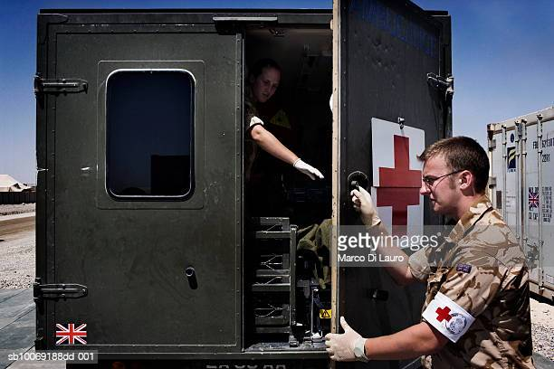 5 May 2007 British military medical personnel from the UK Med Group close the door of the ambulance that is moving British Army soldier Pte Alexander...