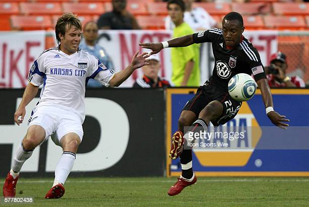 DC's Rodney Wallace and Kansas City's Michael Harrington DC United defeated the Kansas City Wizards 21 at RFK Stadium in Washington DC in a regular...