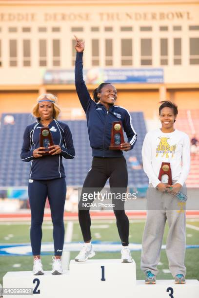 Michelle Cumberbatch of Lincoln University celebrates on the podium following her victory in the Women's 400 Meter Hurdles at the NCAA Division II...