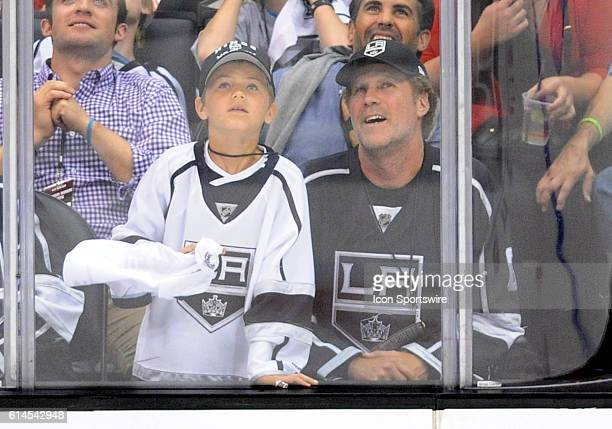 Actor Will Ferrell with one of his sons in attendance at center ice during game 4 of the Western Conference Final between the Chicago Blackhawks and...