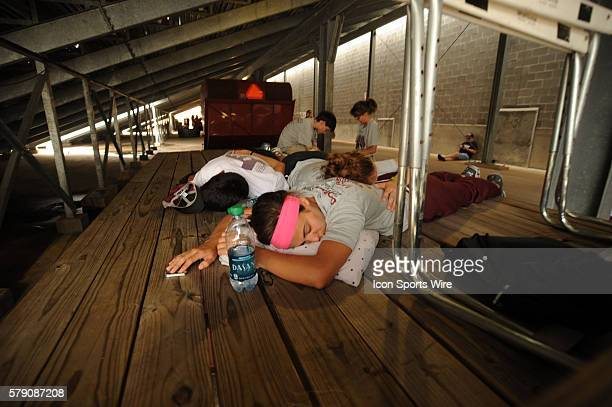 Competitors take in a nap between events at the Texas state UIL meet at Mike A Myers Stadium in Austin Texas