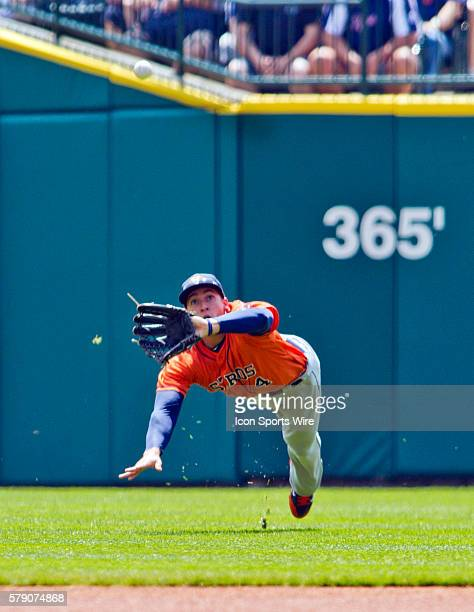 Houston Astros right fielder George Springer makes a diving catch in the outfield during the Houston Astros at Detroit Tigers Major League Baseball...