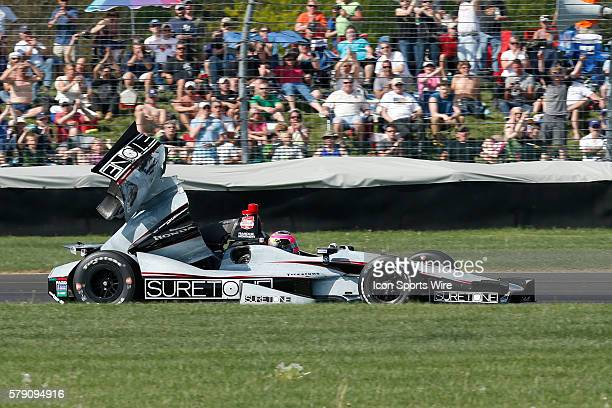 Indycar driver Franck Montagny has parts of his car fly off after an earlier accident during the Grand Prix Of Indianapolis at the Indianapolis Motor...