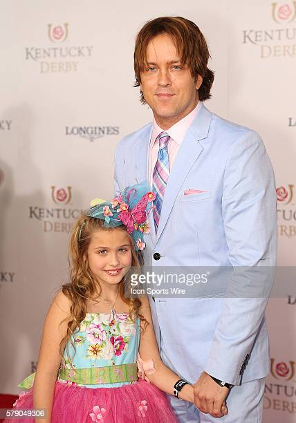 Larry Birkhead and his daughter Dannielynn arrive on the red carpet before the 140th running of the Kentucky Derby at Churchill Downs in Louisville Ky