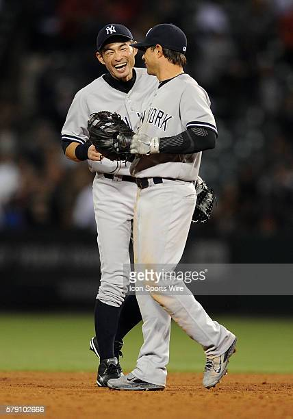 New York Yankees left fielder Ichiro Suzuki with Brain Roberts after the Yankees defeated the Los Angeles Angels of Anaheim 9 to 2 in a game played...