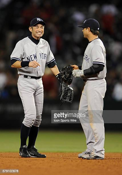 New York Yankees left fielder Ichiro Suzuki with Brian Roberts after the Yankees defeated the Los Angeles Angels of Anaheim 9 to 2 in a game played...