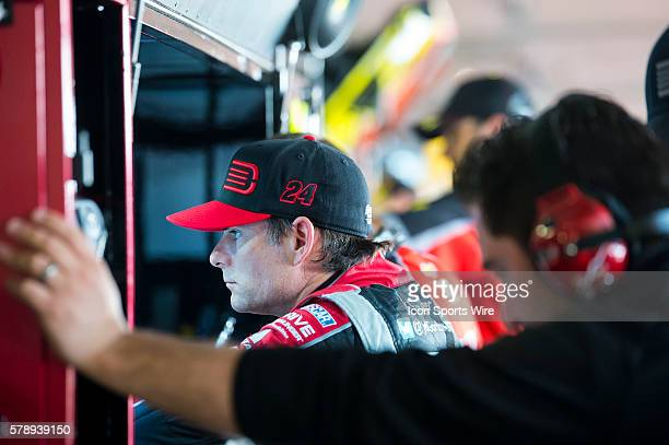 Sprint Cup Series driver Jeff Gordon reviews telemetry data in the garage after practice for the FedEx Autism Speaks 400 at Dover International...