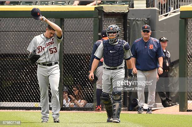 Battery mates Detroit Tigers catcher Alex Avila and Detroit Tigers starting pitcher Kyle Lobstein leaving the bullpen prior to playing in a baseball...