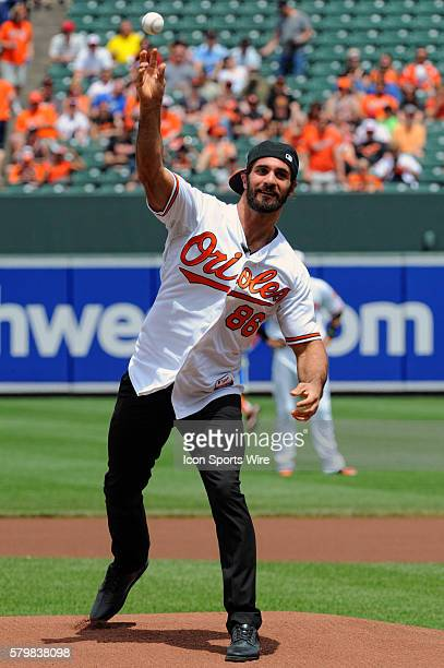 Current WWE World Heavyweight Champion Seth Rollins prepares to throw out the first pitch at Orioles Park at Camden Yards in Baltimore MD where the...