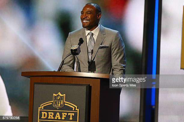 Former Dallas Cowboy Darren Woodson makes their pick during round 2 of the 2015 The NFL Draft is being held at the Auditorium Theatre in Chicago IL