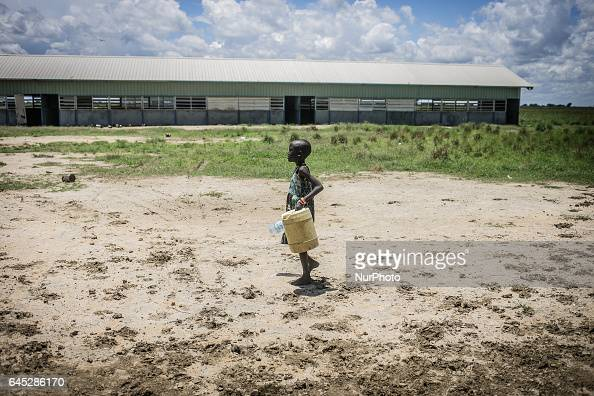 May 2015 Jonglei State South Sudan Girl carrying small jerry can with water On 20 February 2017 the United Nations declared a famine in parts of...