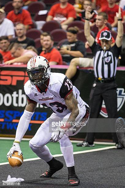 Orlando Predators WR Lamark Brown in the end zone after making a touchdown catch as Cleveland Gladiators DB Fred Shaw and Cleveland Gladiators DB...