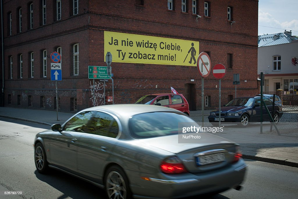 May 2016 - A banner is seen warning motor vehicle drivers to look out for elderly and disabled pedestrians. Traffic accidents statistics in Poland have until recently been some of the highest in the EU.