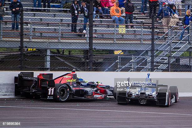IndyCar driver Sebastien Bourdais and IndyCar driver Tony Kanaan crash going into the first turn during the running of the Angie's List Grand Prix of...