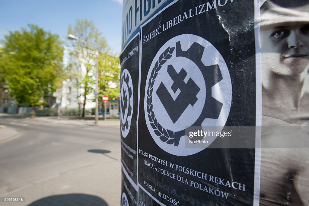 May 2016 - Posters are seen on an advertising silo advocating the death of liberalism. The symbol on the poster is the same as used by the National Radical Camp (ONR) a far-right nationalist and quasi fascist group. The group is also associated with Catholic youth groups such as the Altruist group based in the Saint Peter and Paul basilica in Bydgoszcz. Nationalism has been on the rise in Poland since the ultra conservative PiS party gained a majority in the last elections in 2015.