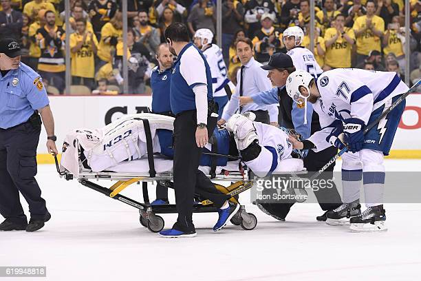 Tampa Bay Lightning defenseman Victor Hedman gives goalie Ben Bishop a tap as he leaves the ice on a stretcher after suffering an apparent injury...