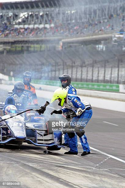 14 May 2016 | The brakes catch on fire during a pit stop for Preferred Freezer Chevrolet driver Josef Newgarden during the Angie's List Grand Prix of...