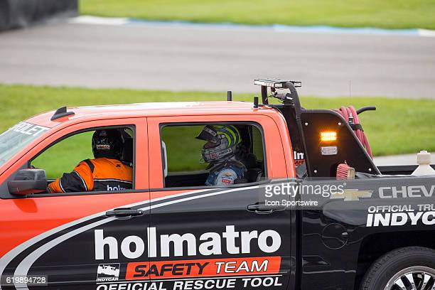 IndyCar driver Tony Kanaan is being assisted by a Holmatro Safety Team member following an accident at the start of the Angie's List Grand Prix of...