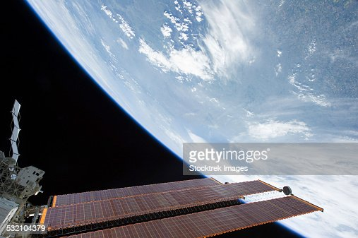 May 21, 2011 - International Space Station solar array panels and a blue and white part of Earth.