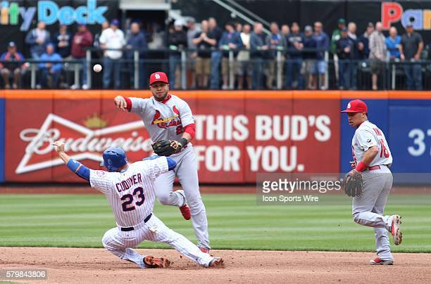 New York Mets Left field Michael Cuddyer [2799] slides under St Louis Cardinals Shortstop Jhonny Peralta [3514] in an attempt to break up a double...