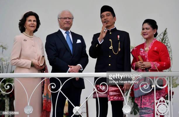 Indonesian President Joko Widodo and his wife Iriana show a Bogor botanical graden to Swedish King Carl XVI Gustav and Queen Silvia during their...