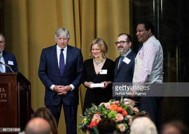 NEW YORK May 22 2017 Staff of the New York Daily News and ProPublica and Lee C Bollinger president of Columbia University are seen on the stage...