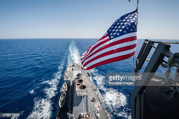 May 23, 2013 - The national ensign flies from the mast aboard the guided-missile destroyer USS Stockdale.