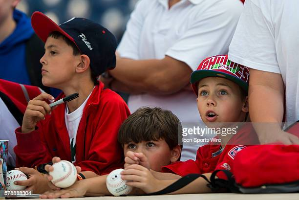 Young Phillies fans watch batting practice in awe before a Major League Baseball game between the Philadelphia Phillies and the Los Angeles Dodgers...