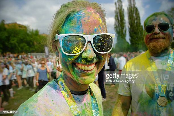 A reveller participates in the Color Run in Stockholm Sweden May 22 2016 Thousands of people in Stockholm drenched themselves in a rainbow of colors...
