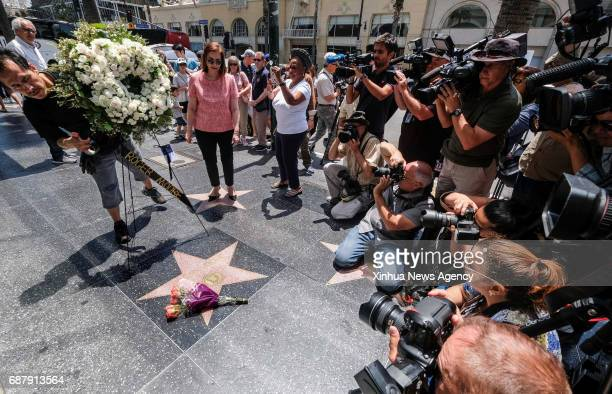 LOS ANGELES May 23 2017 Flowers are placed on the Hollywood Walk of Fame star of Roger Moore in Los Angeles the United States on May 23 2017 Moore...