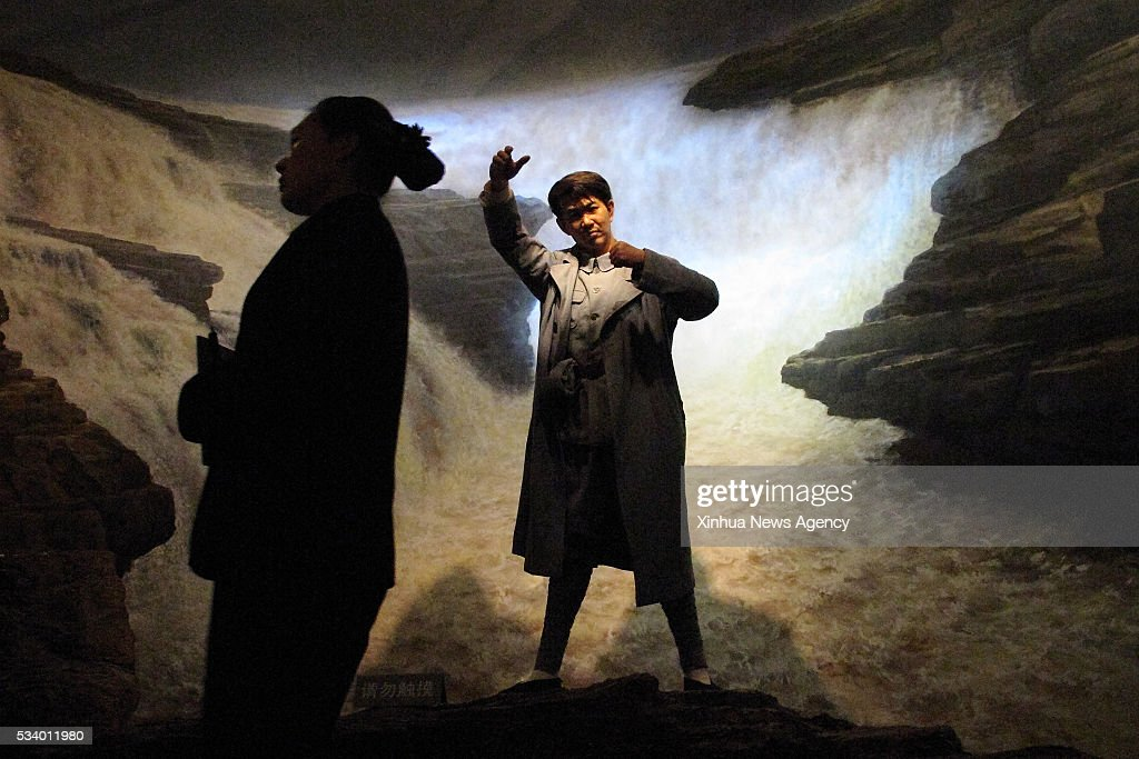 BEIJING, May 24, 2016 -- A staff member walks pass a wax sculpture of great Chinese composer Xian Xinghai at the wax museum of the National Museum of China in Beijing, capital of China, May 24, 2016. The wax museum, founded in 2002, reopened on Tuesday after it was closed in 2006.