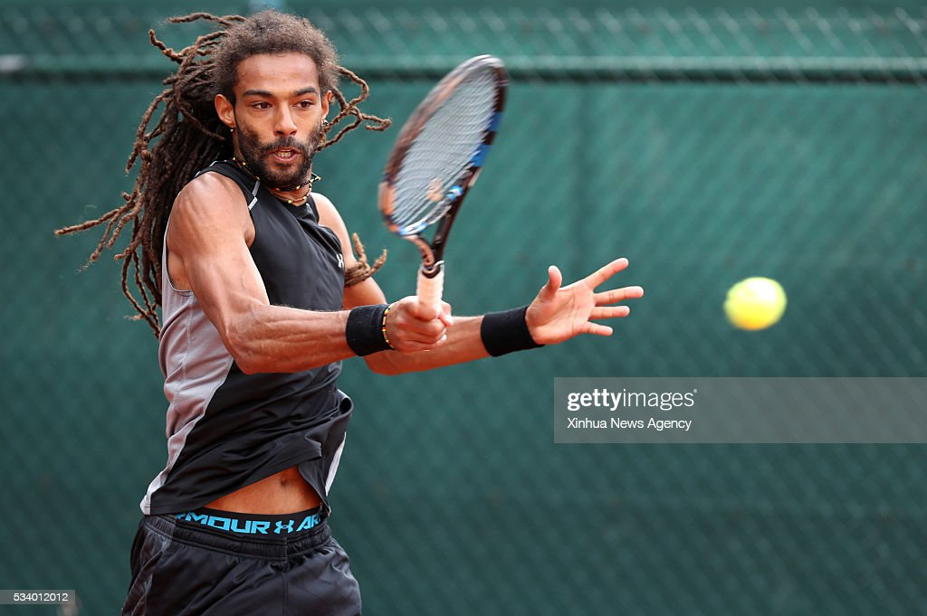 PARIS, May 24, 2016 -- Dustin Brown of Germany competes during the men's singles first round match against Dudi Sela of Isreal on day 2 of 2016 French Open tennis tournament at Roland Garros, in Paris, France on May 23, 2016. Brown won 3-2.