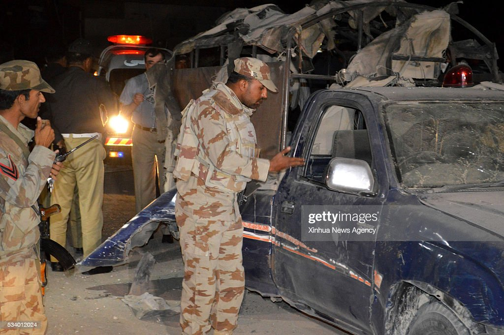 QUETTA, May 24, 2016-- Pakistani soldiers inspect a damaged police vehicle at the blast site in southwest Pakistan's Quetta on May 24, 2016. At least one policeman was killed and 11 others were injured when a bomb went off near a police vehicle in Pakistan's southwest Quetta city on Tuesday night, local Urdu media reported.