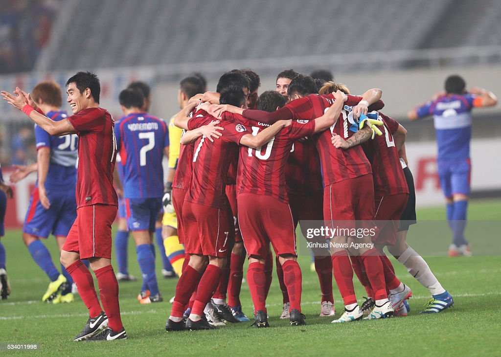 SHANGHAI, May 24, 2016 -- Players of China's Shanghai SIPG celebrate for goal during the second round of 1/8 finals against Japan's FC Tokyo at the Asian Football Confederation Asian Champions Legaue in Shanghai, China, on May 24, 2016. Shanghai SIPG won 1-0.