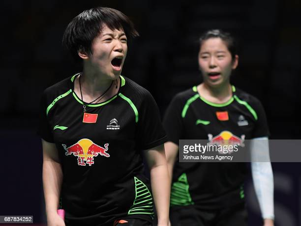 COAST May 24 2017 China's Chen Qingchen and Jia Yifan celebrate during the women's doubles match of Group 1Group 1A against Thailand's Sapsiree...