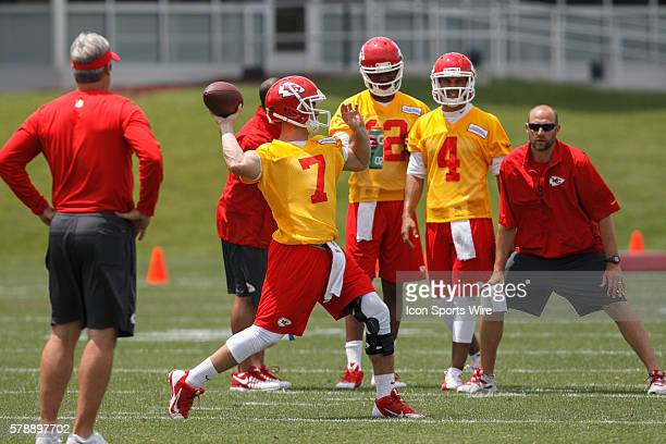 Quarterback Aaron Murray throws a pass as Terrance Owens and Jonathon Jennings look on during the Kansas City Chiefs rookie minicamp at the...