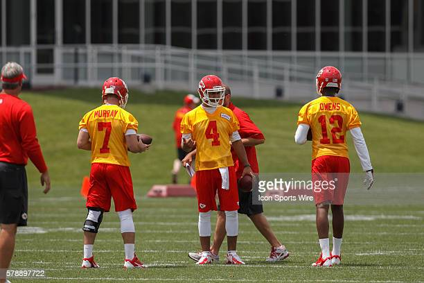 Quarterbacks Aaron Murray Jonathon Jennings and Terrance Owens talk during the Kansas City Chiefs rookie minicamp at the University of Kansas...