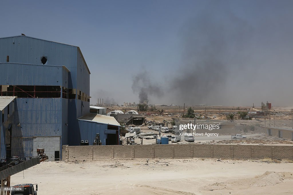 BAGHDAD, May 25, 2016-- A cement factory is hit by rockets during battles between iraqi army and Islamic States militants on the outskirts of Fallujah in Iraq's western Anbar province, on May 25, 2016. Iraqi security forces on Wednesday extended control on areas around the IS-held city of Fallujah in the province of Anbar, at the third day of an offensive aimed at flushing out the extremist militants from the city, a provincial security source said.