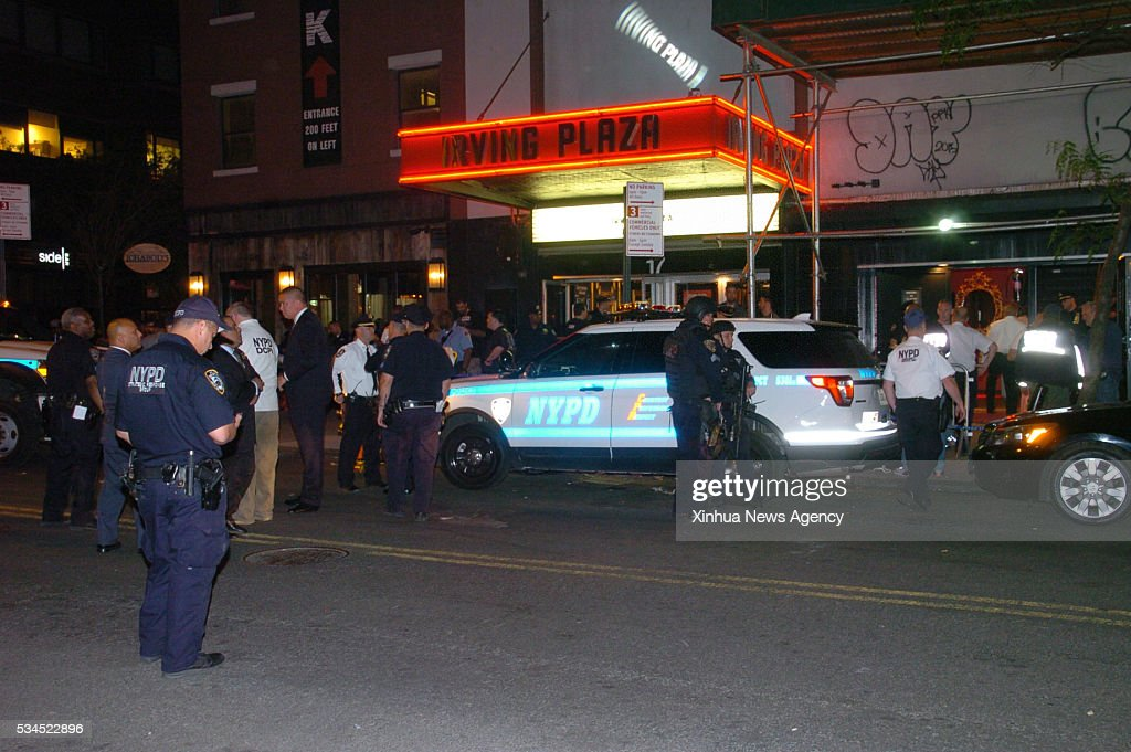 Policemen gather outside the building of Irving Plaza in new york, the United States, May 25, 2016. One person was killed and three others injured in a shooting incident Wednesday night during a concert by U.S. rapper T.I. at Irving Plaza in New York City, police said.
