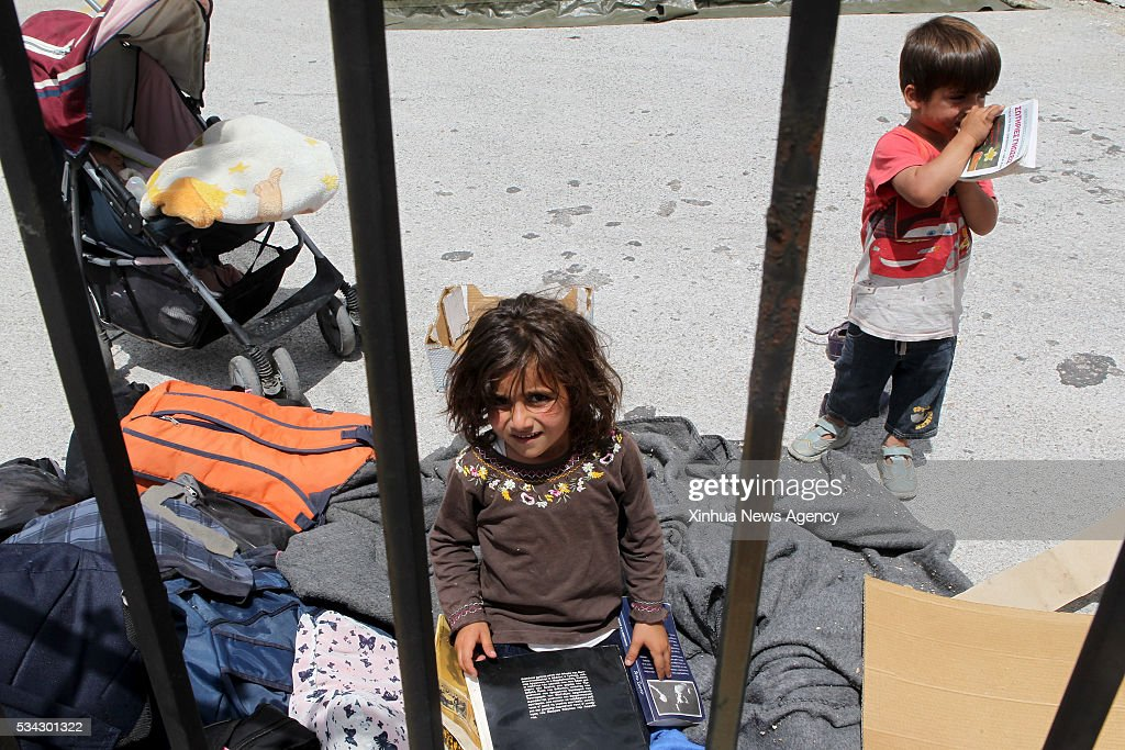 THESSALONIKI, May 25, 2016 -- Refugee children are pictured inside the newly established organized refugee reception center of Derveni near Greek northern city of Thessaloniki on May 25, 2016. During a police operation launched on Tuesday, thousands of refugees have been relocated from the makeshift refugee camp of Idomeni at the border between Greece and the Former Yugoslav Republic of Macedonia to nearby state-run reception facilities.