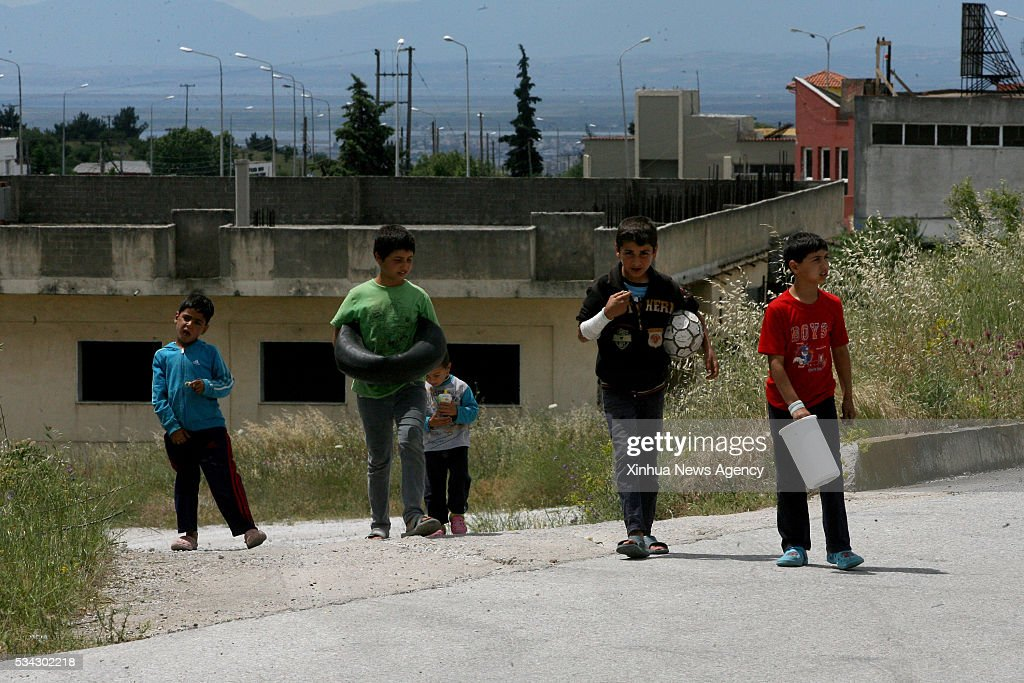 THESSALONIKI, May 25, 2016-- Refugee children are pictured inside the newly established organized refugee reception center of Derveni near Greek northern city of Thessaloniki on May 25, 2016. During a police operation launched on Tuesday, thousands of refugees have been relocated from the makeshift refugee camp of Idomeni at the border between Greece and the Former Yugoslav Republic of Macedonia to nearby state-run reception facilities.