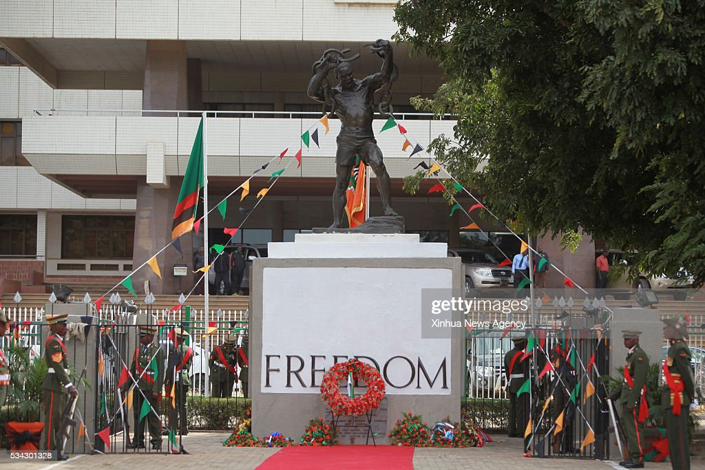 LUSAKA, May 25, 2016 -- Soldiers stands next to the Freedom Statue during a wreath-laying ceremony in honor of fallen freedom fighters in Lusaka, capital of Zambia, May 25, 2016. Zambia commemorated the Africa Freedom Day in colorful celebrations.