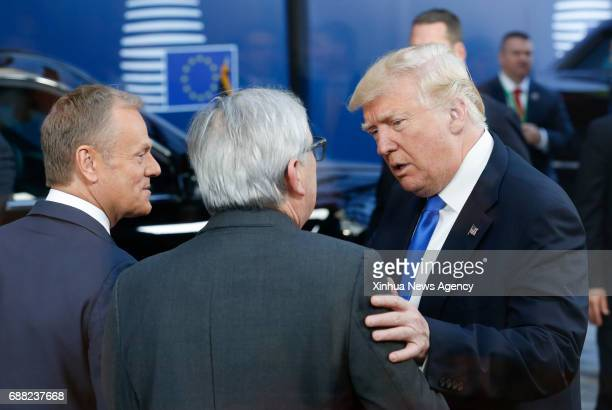 BRUSSELS May 25 2017 US President Donald Trump talks with European Commission President JeanClaude Juncker and European Council President Donald Tusk...