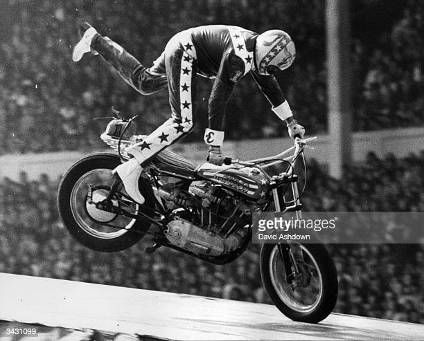 American stunt motorcyclist Evel Knievel coming in to land after a 90 mph leap over 13 singledeck buses to a crash landing in which he fractured his...